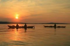 Sunset Kayakers royalty free stock photo
