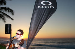 Sunset with Kelley James. Kelley James performing at the Oakley house on the North Shore of Hawaii Stock Image
