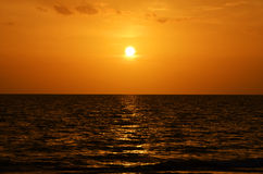 Sunset at Key Largo Florida. Sunset behind a Florida Key from the coast of Key Largo stock photo