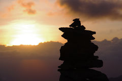 Sunset on Kilimanjaro. Silhouette of a stone pyramid on sunset background Stock Image