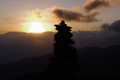 Sunset on Kilimanjaro. Silhouette of a stone pyramid on sunset background Stock Images