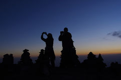 Sunset on Kilimanjaro. Silhouettes photographing people on the sunset background Royalty Free Stock Images