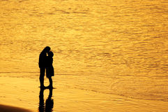 Sunset kiss Stock Images