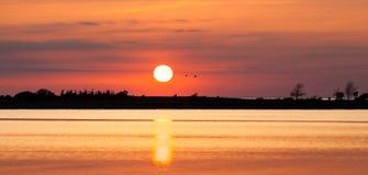 Sunset in Klintehamn Gotland. Sun reflection in tranquil water Stock Photo