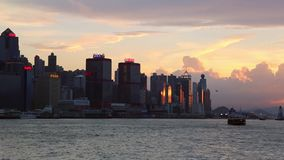 Sunset in Kowloon Bay with Ferry at Hong Kong harbor, cityscape background stock video footage