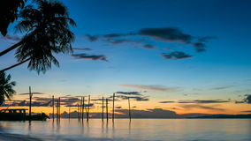 Sunset on Kri Island. Boats under Palmtrees. Raja Ampat, Indonesia, West Papua. Sunset on Kri Island. Boats under Palmtrees. Raja Ampat, Indonesia. West Papua Stock Images