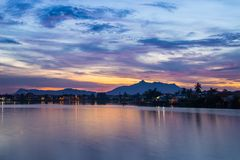 Sunset in Kuching, Borneo. Colorful sunset on the Sarawak River from the Waterfront Promenade in Kuching, Borneo, Malaysia royalty free stock photography