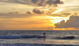 Sunset on Kuta beach in Bali Royalty Free Stock Images