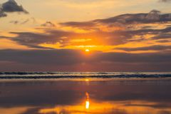 Sunset on the Kuta beach with reflection in the water on the isl. And of Bali Royalty Free Stock Image