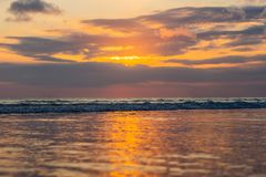 Sunset on the Kuta beach with reflection in the water on the isl. And of Bali Royalty Free Stock Photography