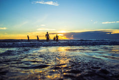 Sunset kuta beach. Kuta is a beach and resort area in the south of the island of Bali, Indonesia. One of Bali's first tourist developments, it's best known for stock photography