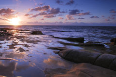 Sunset in La Jolla Cove. Sunset view at the coastal rocks in La Jolla Cove in San Diego stock image