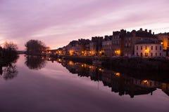 Sunset in La Vilaine river with Redon city. Ile et Vilaine , France Stock Photos