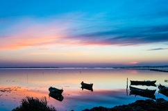 Sunset on the lagoon with fisherman boats Stock Photos