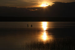 Sunset on the lake. With two woman Stock Image
