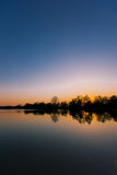 Sunset at a lake. Here you can see a sunset at a lake stock photos