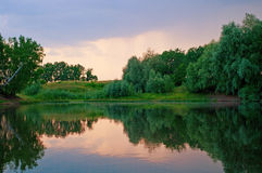 Sunset on the lake. The beautiful sunset on the lake. Shallow DOF Stock Photography