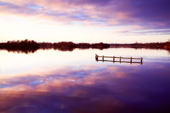 Sunset on lake. Silent colorful sunset on the big lake Stock Image