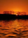 Sunset on lake. A view of the last rays of sunlight across Wiltshire lake in England Stock Photography