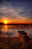 Sunset by the lake. Summer sunset on a lake with a boat in the foreground Royalty Free Stock Photo