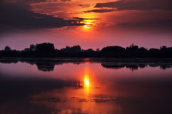Sunset by the lake. Beautiful sunset reflecting in a lake stock photography