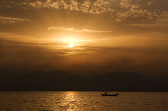 Sunset on the lake. With a fisherman royalty free stock photos