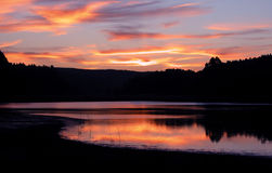 Sunset in the lake. Beautiful sunset in the lake with reflection in the water royalty free stock photography
