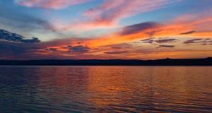 Sunset on the lake. Beautiful romantic sunset on the lake Stock Photo