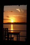 Sunset at the lake. Chair and table on the balcony at the Lago e Peten Itza, Guatemala Royalty Free Stock Photography