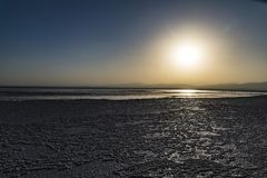 Sunset at Lake Assale, Ethiopia. The Danakil depression — specifically the area surrounding Lake Afdera — is the place from which close to 100% of the salt Royalty Free Stock Images