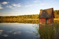 Sunset on the lake in the autumn. Laker landscape on a background of a decline in autumn Stock Photo