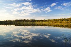 Sunset on the lake in the autumn. Lake landscape on a background of a decline in autumn Stock Photography