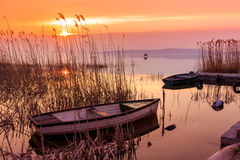 Sunset on the lake Balaton with a boat Royalty Free Stock Photo