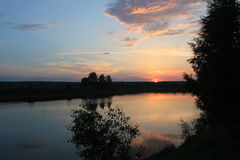 Sunset on the lake. Beautiful sunset in Belarusian lake.Swimming at sunset Royalty Free Stock Image