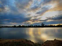 Sunset at the Lake. Beautiful clouds reflected on the lake at sunset Stock Image