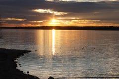 Sunset at Lake Benbrook. Lake Benbrook at Sunset with clouds and Ducks Royalty Free Stock Photo