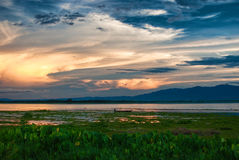 Sunset at the lake. Sunset in the lake and blue sky Royalty Free Stock Images