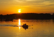 Sunset on the lake,  boat Royalty Free Stock Image