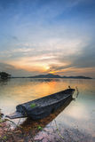 Sunset on the lake with a boat.. Stock Image