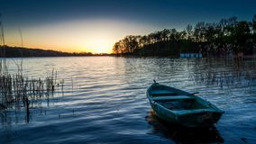 Sunset with the lake with a boat, timelapse. 4k stock footage