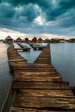 Sunset lake Bokod with pier Stock Photos