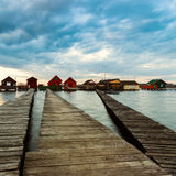 Sunset lake Bokod with pier and fishing wooden cottages Stock Photography