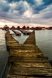 Sunset lake Bokod with pier and fishing wooden cottages Royalty Free Stock Image
