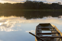 Sunset on a lake with canoe, Madidi National Park. Bolivia Royalty Free Stock Photo
