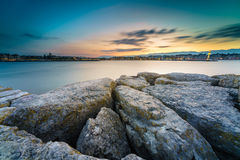 Sunset at lake in the Cityscape. Beautiful view of sunset on the lake of Geneva and the cityscape of Geneva city as silhouette, Switzerland Stock Photography