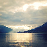 Sunset on Lake Como, near Varenna, Italy. Vintage effect. Royalty Free Stock Image