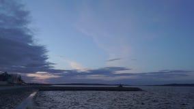 Sunset on lake embankment stock footage