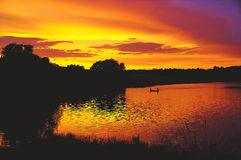 Sunset lake fishing Royalty Free Stock Images