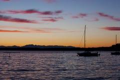 Sunset on lake, focus on boat Royalty Free Stock Image
