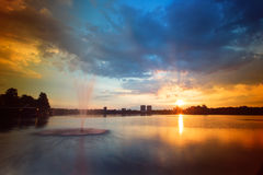 Sunset of the lake with fountains. Royalty Free Stock Images